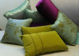 Mixed scatters and bolster cushions all different shapes and sizes